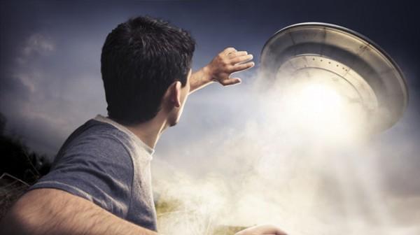 Man-sees-flying-saucer-alien-UFO-via-Shutterstock