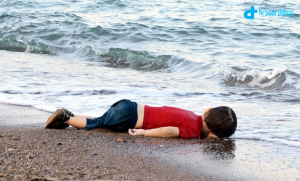 ATTENTION EDITORS - VISUAL COVERAGE OF SCENES OF DEATH OR INJURY A young migrant, who drowned in a failed attempt to sail to the Greek island of Kos, lies on the shore in the Turkish coastal town of Bodrum, Turkey, September 2, 2015. At least 11 migrants believed to be Syrians drowned as two boats sank after leaving southwest Turkey for the Greek island of Kos, Turkey's Dogan news agency reported on Wednesday. It said a boat carrying 16 Syrian migrants had sunk after leaving the Akyarlar area of the Bodrum peninsula, and seven people had died. Four people were rescued and the coastguard was continuing its search for five people still missing. Separately, a boat carrying six Syrians sank after leaving Akyarlar on the same route. Three children and one woman drowned and two people survived after reaching the shore in life jackets. REUTERS/Nilufer Demir/DHA TPX IMAGES OF THE DAY ATTENTION EDITORS - NO SALES. NO ARCHIVES. FOR EDITORIAL USE ONLY. NOT FOR SALE FOR MARKETING OR ADVERTISING CAMPAIGNS. TEMPLATE OUT. THIS IMAGE HAS BEEN SUPPLIED BY A THIRD PARTY. IT IS DISTRIBUTED, EXACTLY AS RECEIVED BY REUTERS, AS A SERVICE TO CLIENTS. TURKEY OUT. NO COMMERCIAL OR EDITORIAL SALES IN TURKEY.