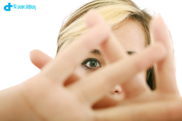 blonde female hide her face behind her hand, keep away gesture, isolated on white background