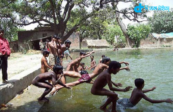 children in the village pond
