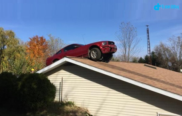 private car on roof of house