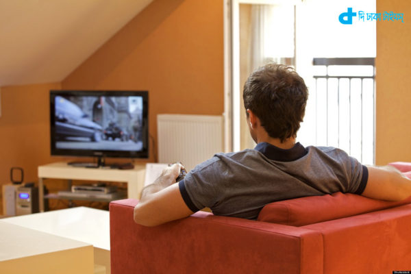 Rear view of young man watching television; Shutterstock ID 67308952; PO: The Huffington Post; Job: The Huffington Post; Client: The Huffington Post; Other: The Huffington Post