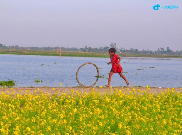 Children playing with bicycle tires and our nature
