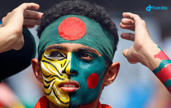 A Bangladeshi fan with Bangladesh's national flag and and tiger painted on his face, looks on during their Cricket World Cup match against Ireland, in Dhaka, Bangladesh, Friday, Feb. 25, 2011. The Royal Bengal Tiger is the national animal of Bangladesh. (AP Photo/Themba Hadebe)